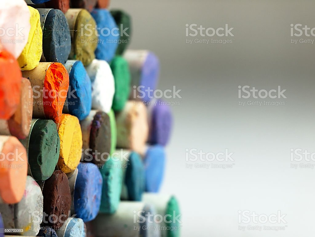 Colored dry pastel crayons closely. stock photo