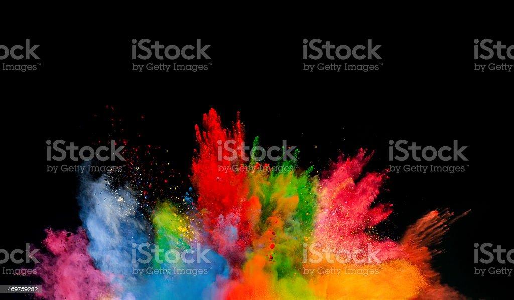 colored dust explosion on black background stok fotoğrafı