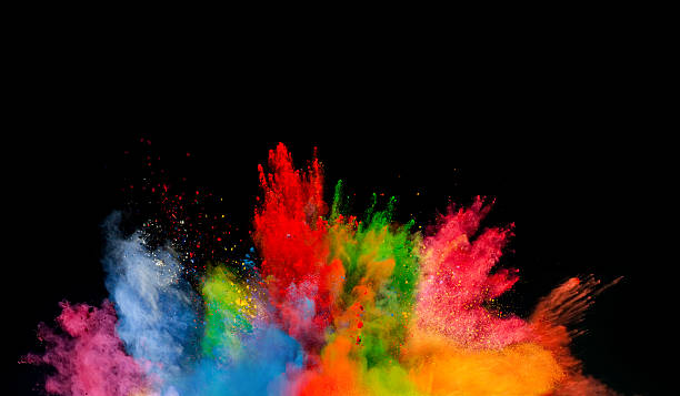 colored dust explosion on black background - kleurenfoto stockfoto's en -beelden