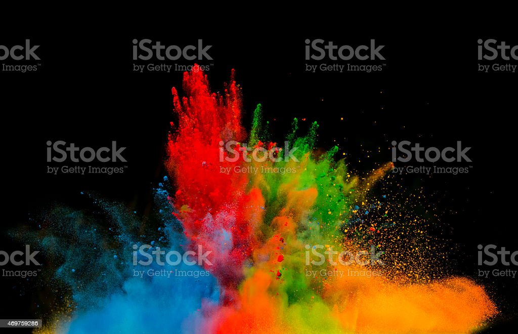 colored dust explosion on black background stock photo