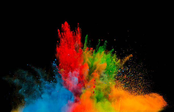 colored dust explosion on black background - abstract multicolored powder explosion stock photos and pictures