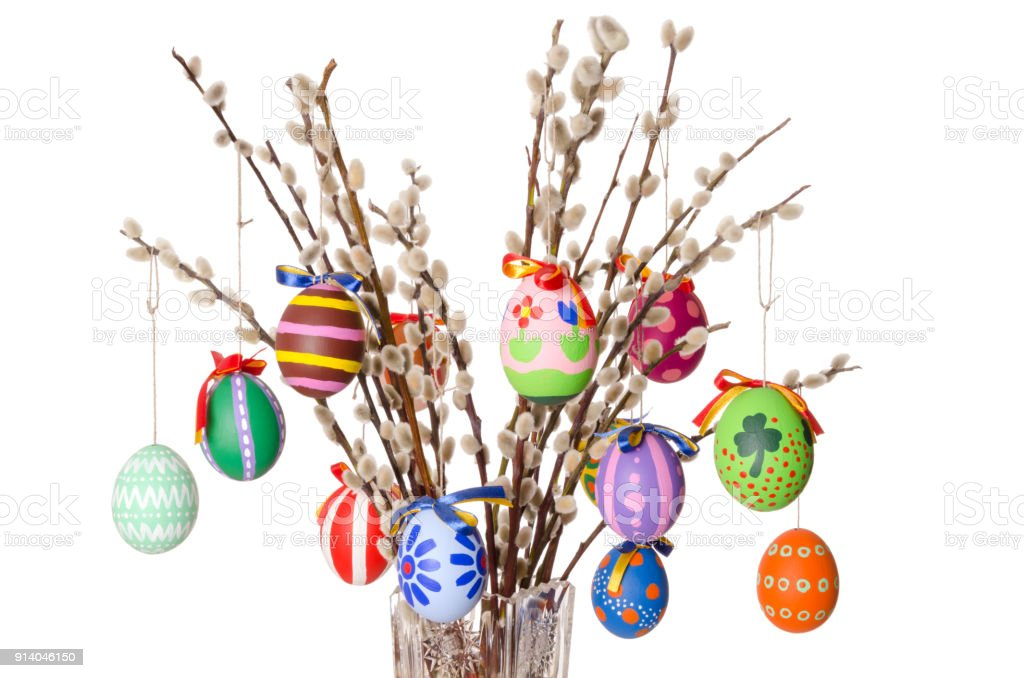 Colored easter eggs on willow bouquet with pussy willows