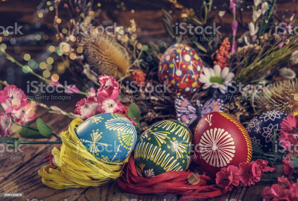 colored easter eggs with wheat ears on the wooden background easter