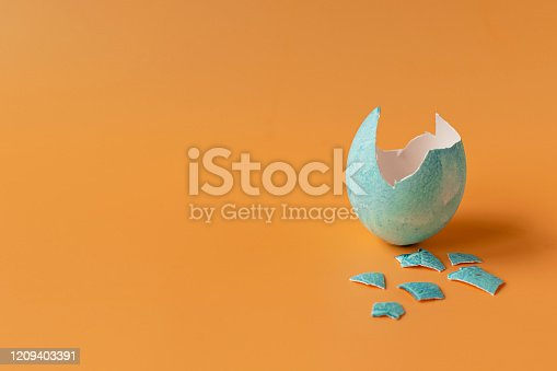 922843504 istock photo Colored eggs on an orange background. Easter holiday, family traditions. Easter eggs. 1209403391