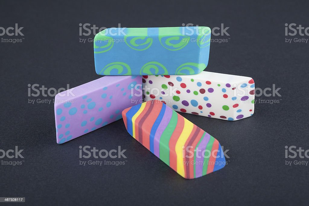 Colored eraser on the black background stock photo