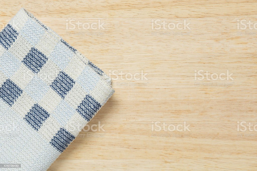 Colored fabric on wooden background. stock photo