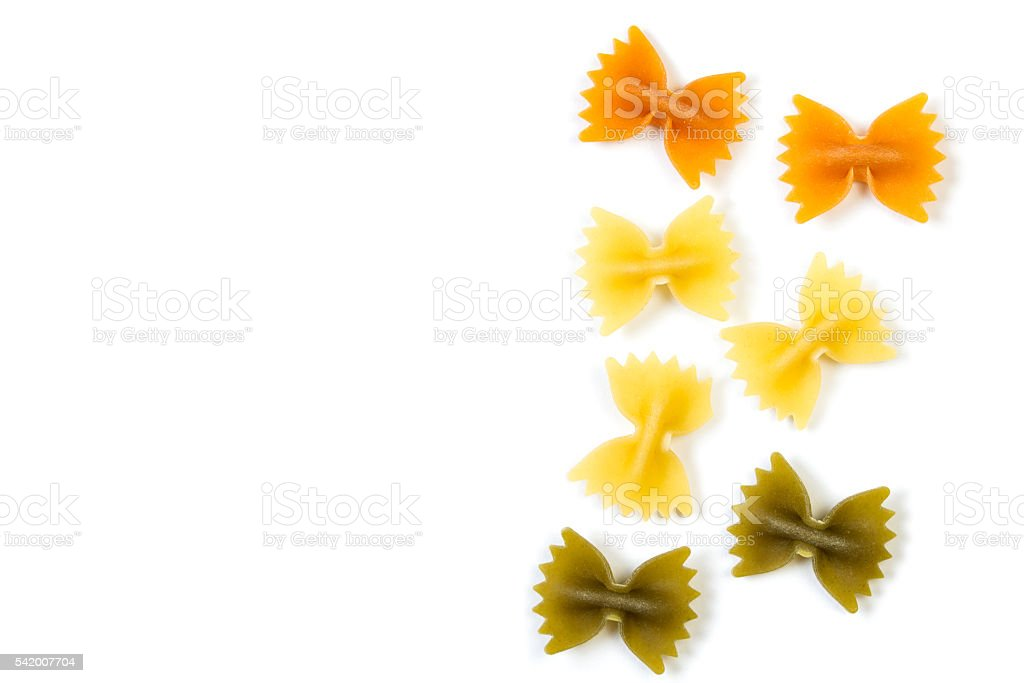 Colored Farfalle pasta isolated on white background stock photo