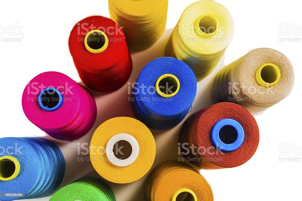 Colored fine thread bobbins royalty-free stock photo
