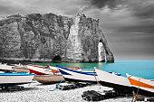 Boats on the peeble beach in Etretat Normandy France