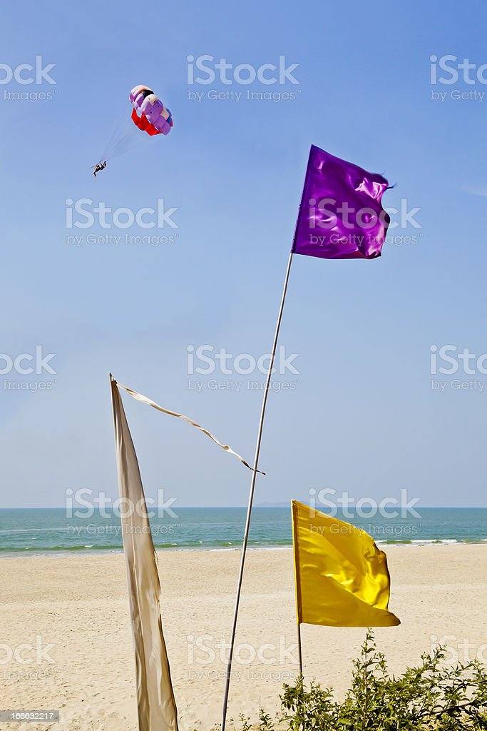 Colored flags breeze and paraglider royalty-free stock photo