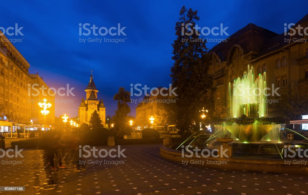 Colored fountain on Victoriei Square with Orthodox Cathedral stock photo