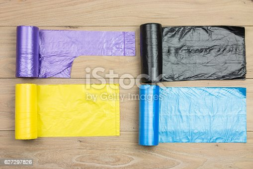 istock Colored garbage bags roll 627297826