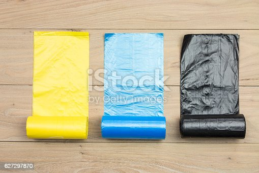 istock Colored garbage bags roll 627297870