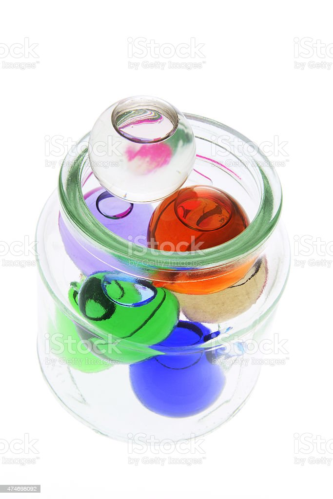 Colored Glass Balls in Jar stock photo