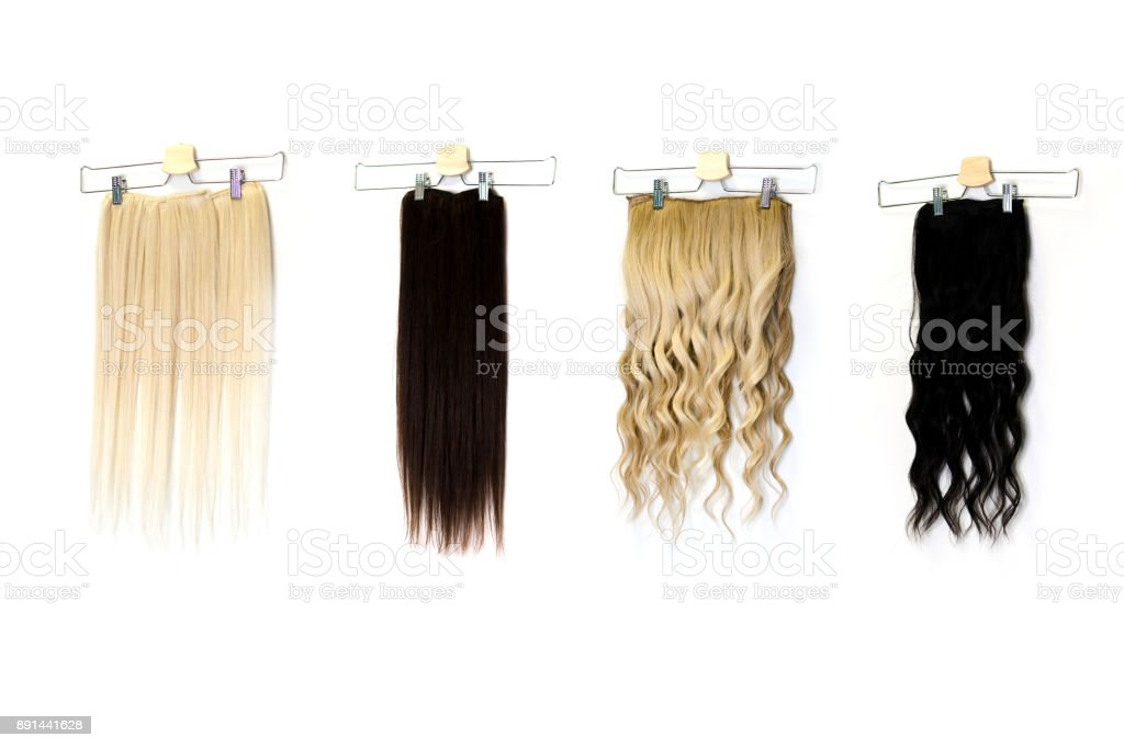 Colored hair extensions on clips in salon stock photo