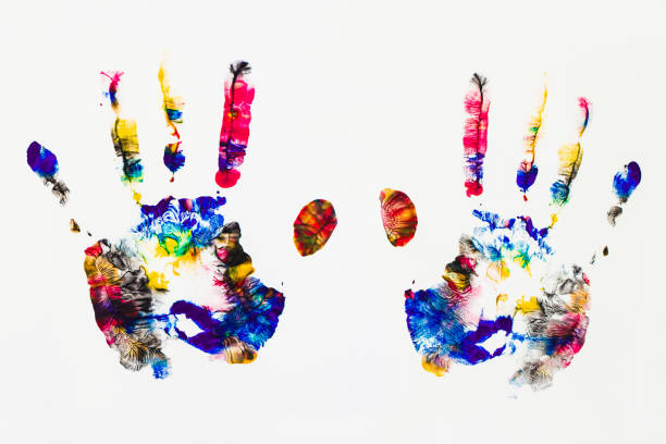 colored hands print on white background stock photo
