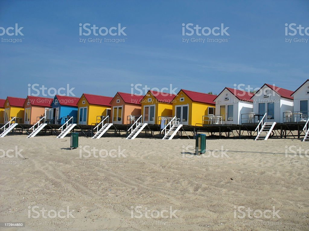 Colored houses on a beach stock photo