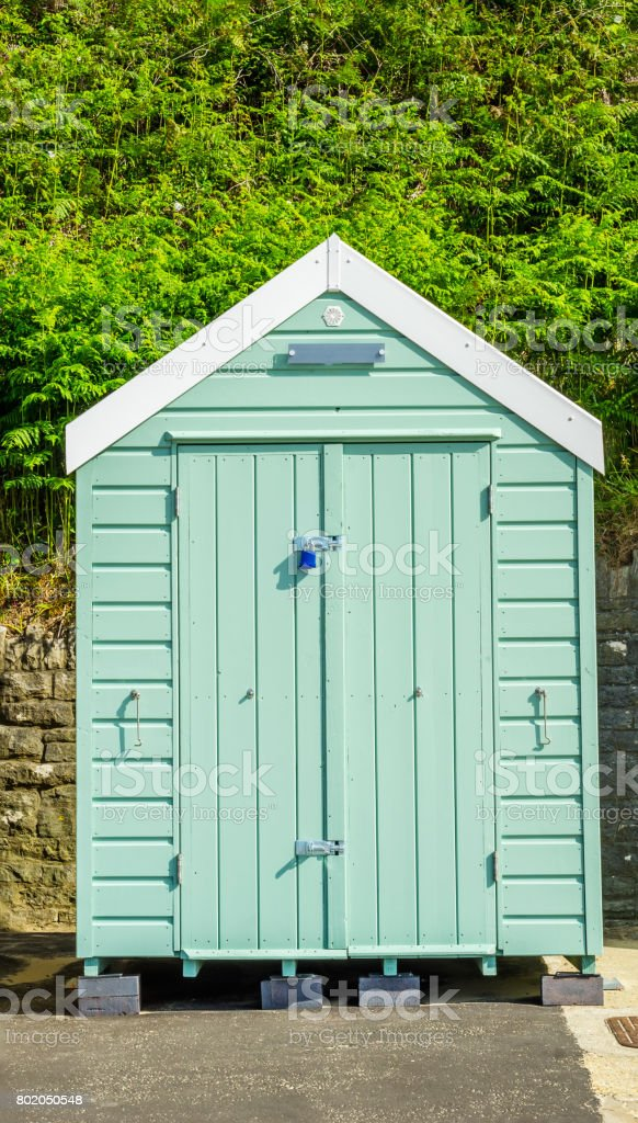 Colored houses on the beach, colorful door to summer cottages, seaside spot stock photo