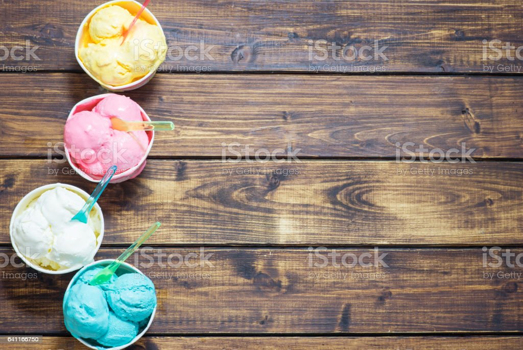 Colored ice cream in cups. stock photo