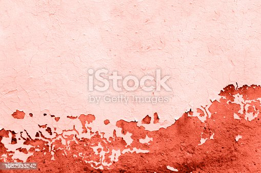 istock colored in color of year 2019 Living Coral background. color 16-1546 grunge textured wall 1082933242