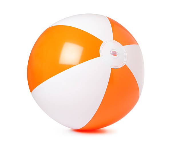 colored inflatable beach ball on white background - beach ball stock photos and pictures