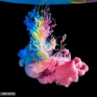 istock Colored inks in water on black background 509735732