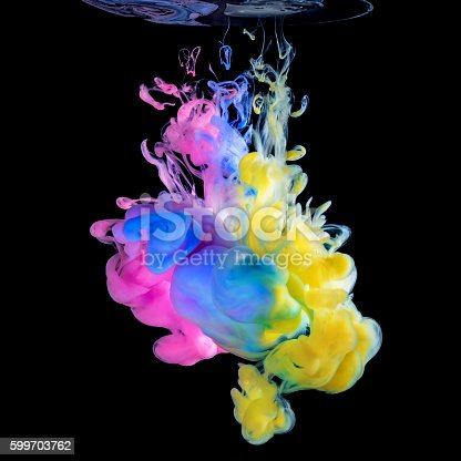 istock Colored inks in water on black background 599703762