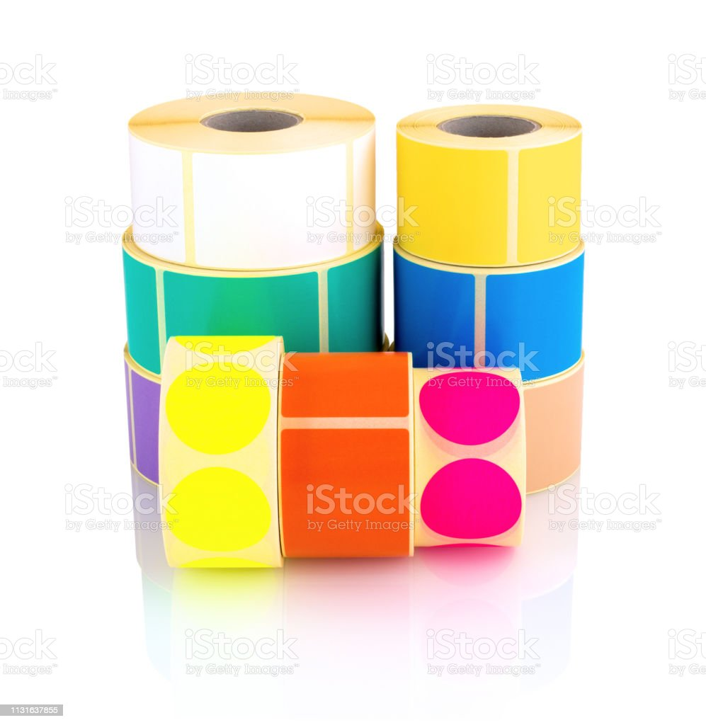 Colored label rolls isolated on white background with shadow...