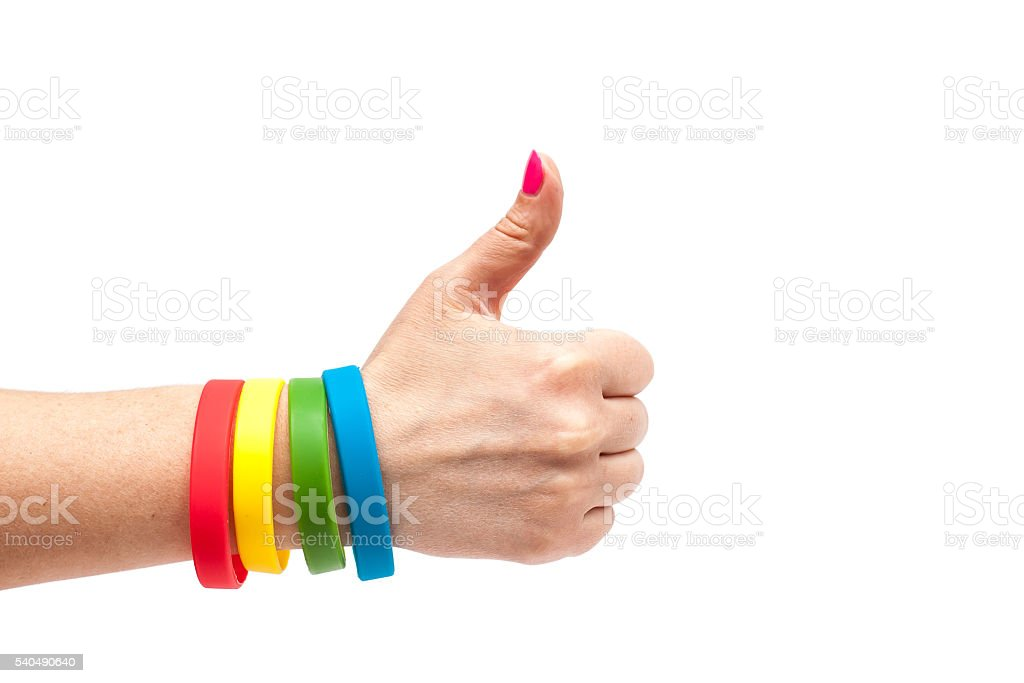Colored latex bracelet on the arm stock photo