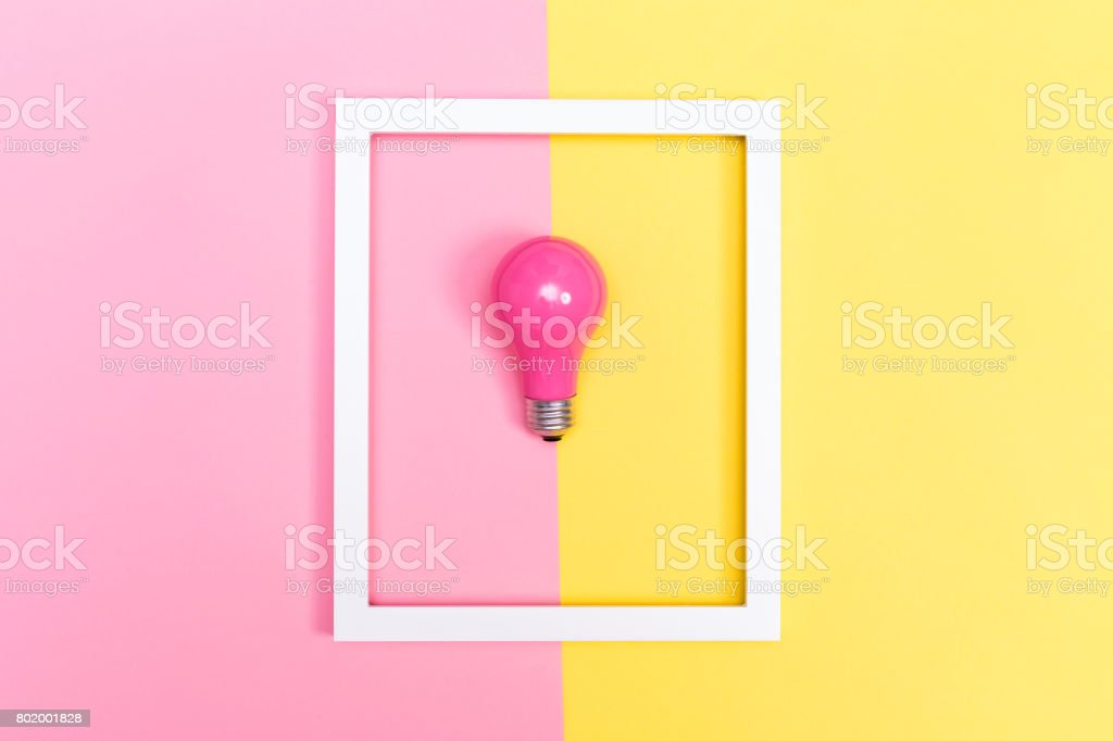 Colored lightbulb on a duotone background stock photo