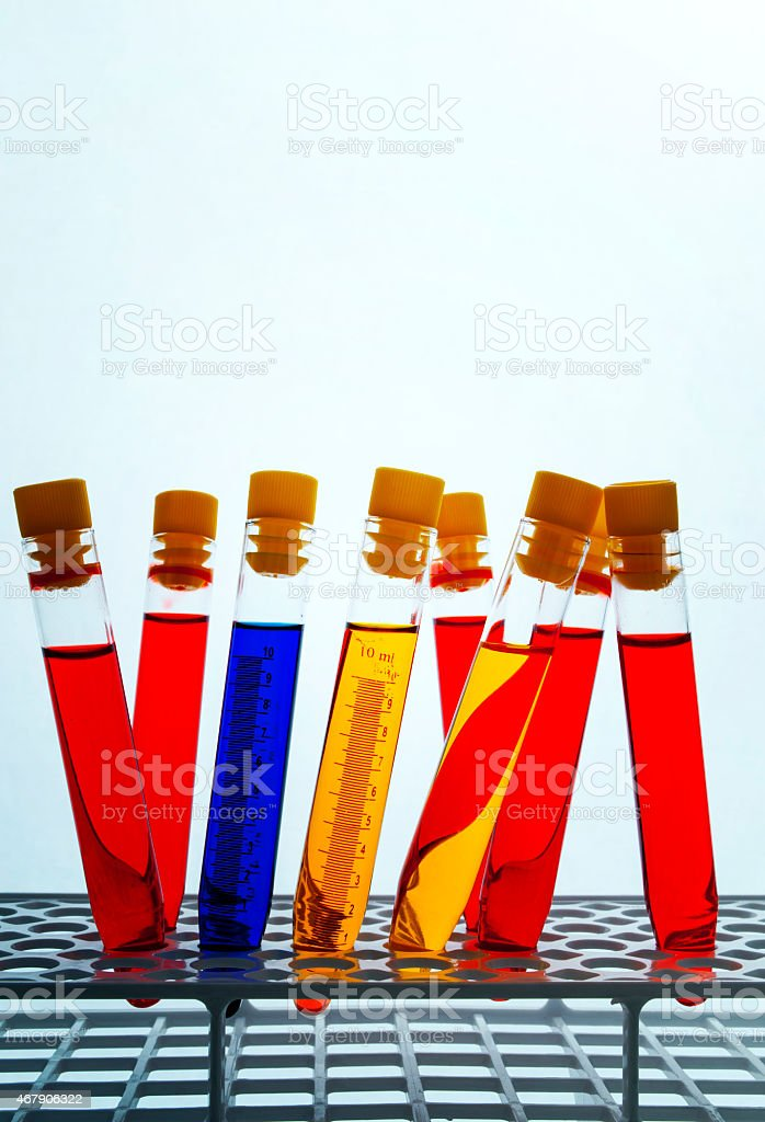 Colored liquids in test tubes stock photo