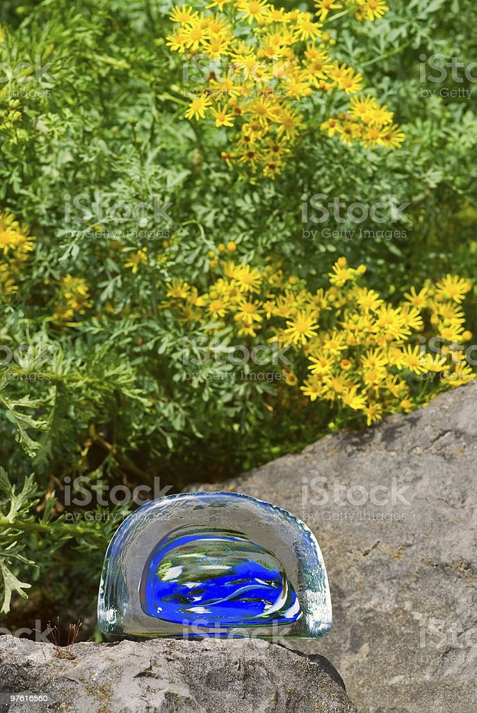 Colored lump of glass meets nature 02 royalty-free stock photo