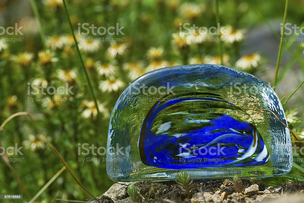 Colored lump of glass meets nature 04 royalty-free stock photo