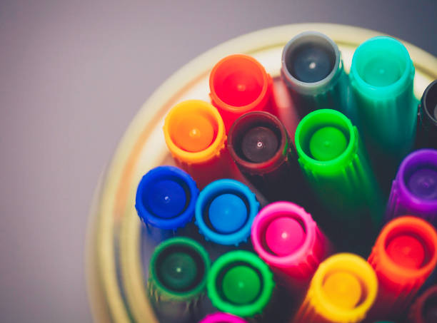 Colored markers in glass jar stock photo