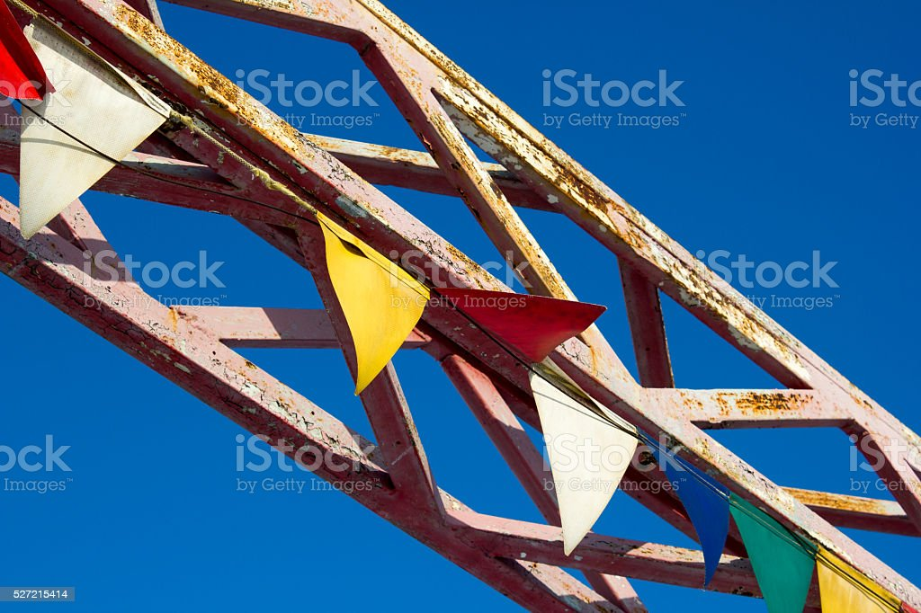 Colored metal construction on blue sky background
