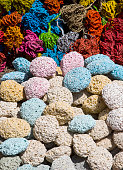 Colored natural pumice stones dried marine algae at the stand on street bazaar in Egypt
