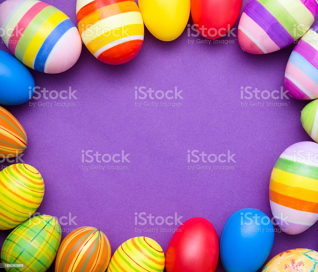 Colored Painted easter egg on purple background royalty-free stock photo