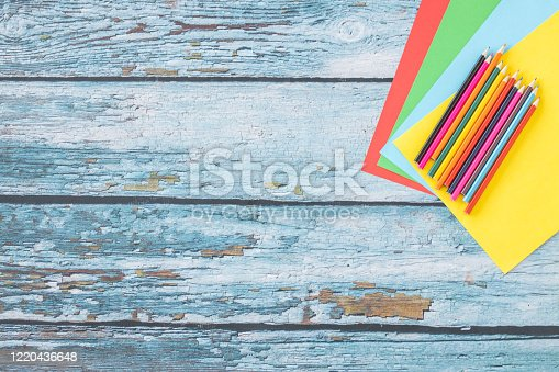 925244914 istock photo Colored paper and colored pencils 1220436648