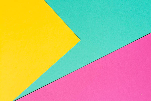 Colored paper in a geometric flat composition. stock photo