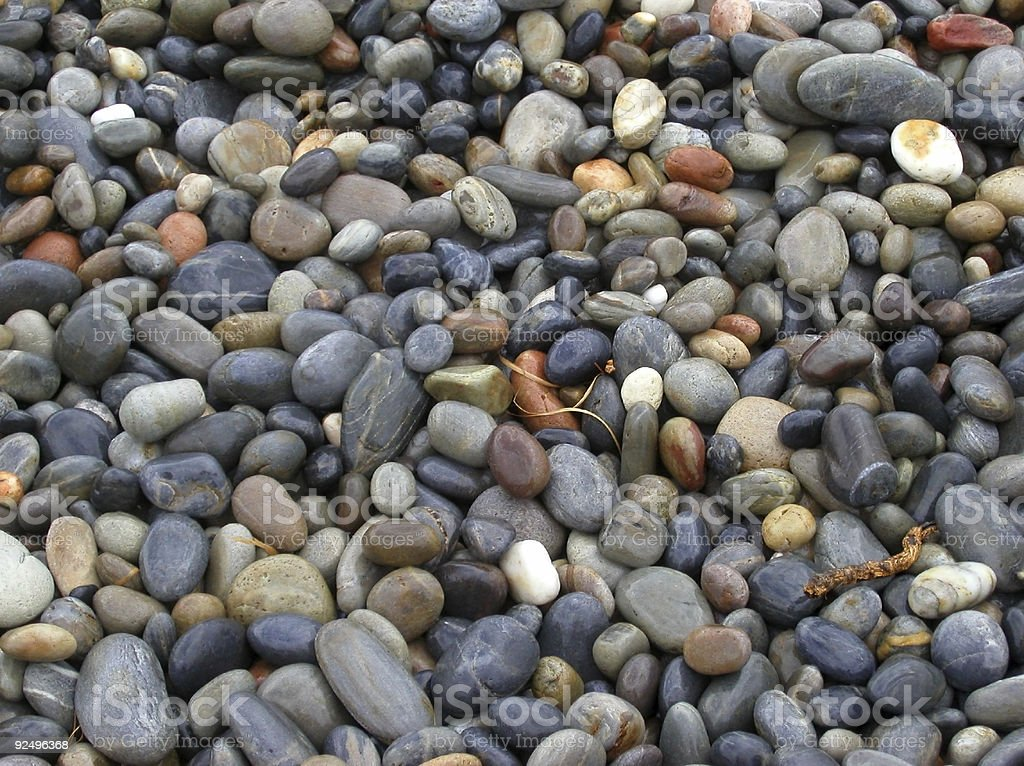 colored pebbles on a mediterranean beach royalty-free stock photo