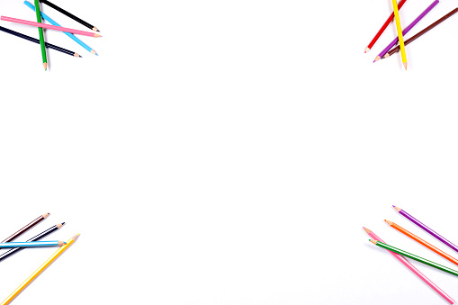A white background, bordered by brightly colored pencils.