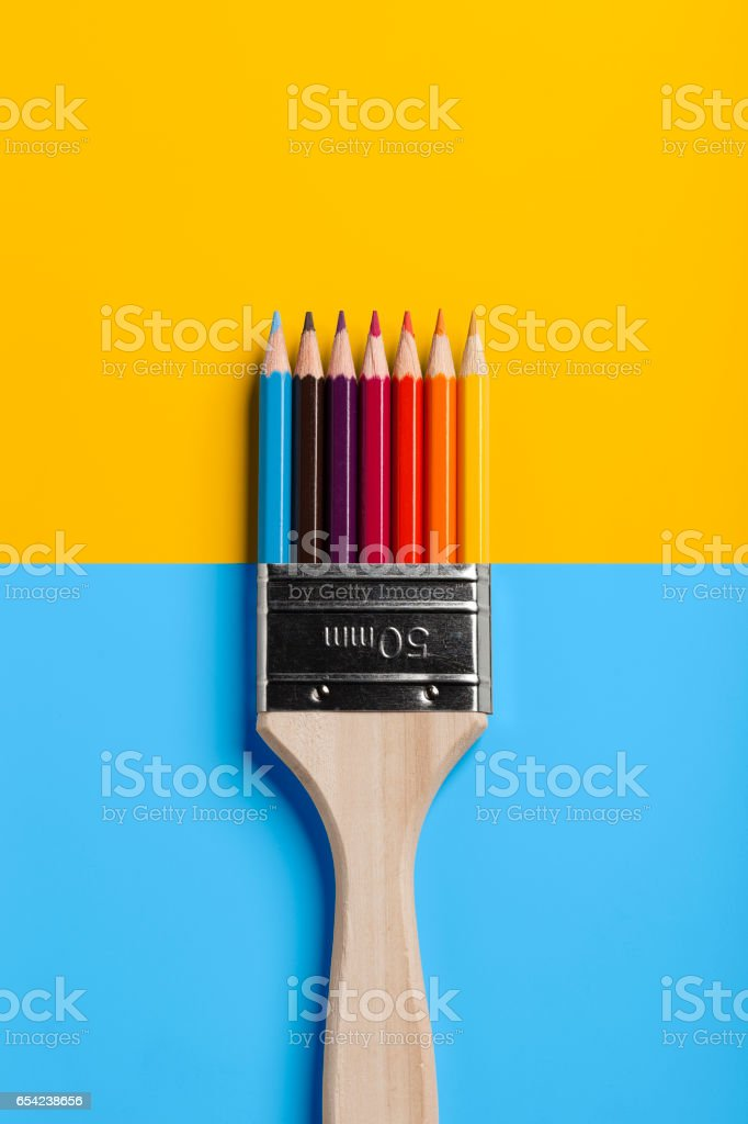 Colored Pencil Paint Brush - Blue Yellow stock photo