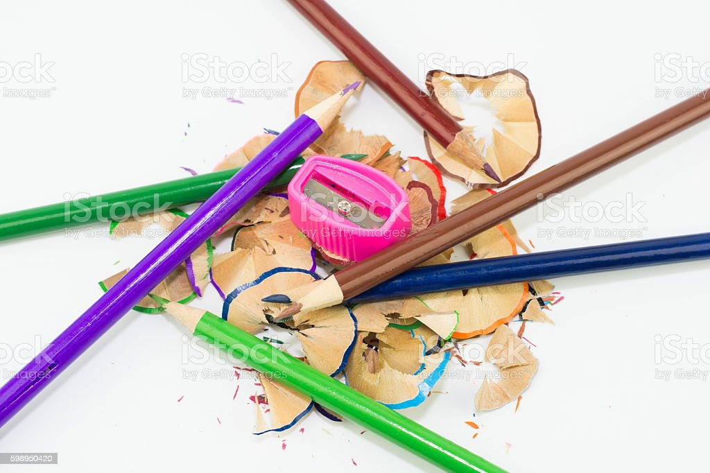 colored pencils and a pencil sharpener stock photo