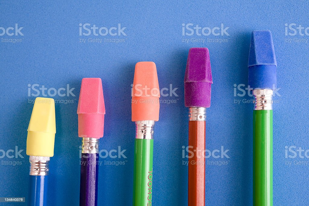 Collection of colored pencils and colorful erasers.