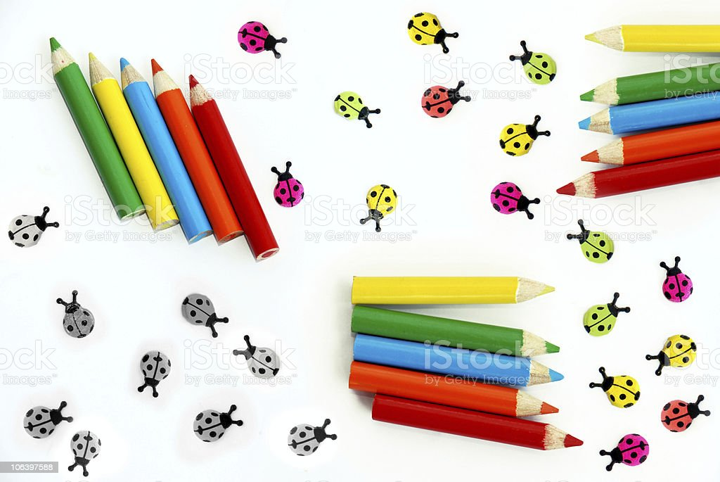 Colored pencils and ladybirds royalty-free stock photo