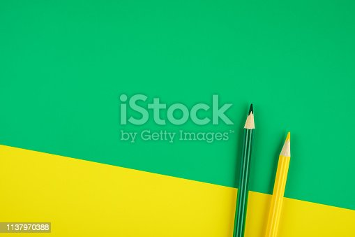 1137970382 istock photo Colored pencils color papers geometry flat composition background 1137970388