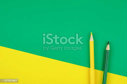 1137970382 istock photo Colored pencils color papers geometry flat composition background 1137970407