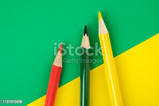 1137970382 istock photo Colored pencils color papers geometry flat composition background 1137970408