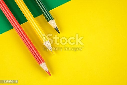 1137970382 istock photo Colored pencils color papers geometry flat composition background 1137970416