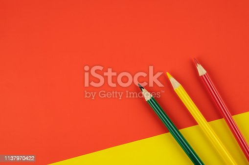 1137970382 istock photo Colored pencils color papers geometry flat composition background 1137970422